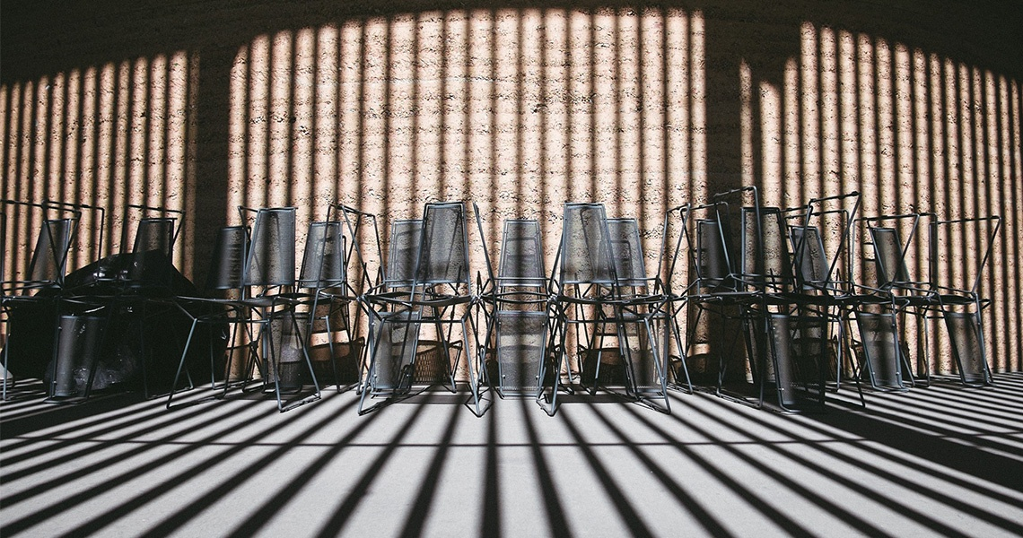 metal outdoor chairs being stored when not in use