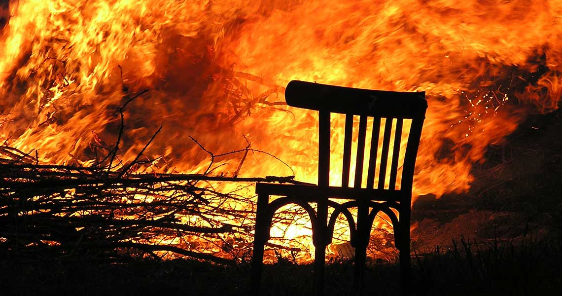 wooden chair on fire