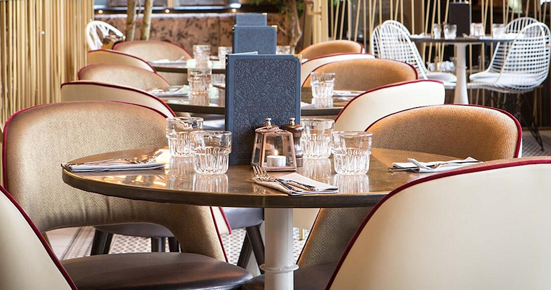 lush chairs and brass tables in Lost and Found Knutsford