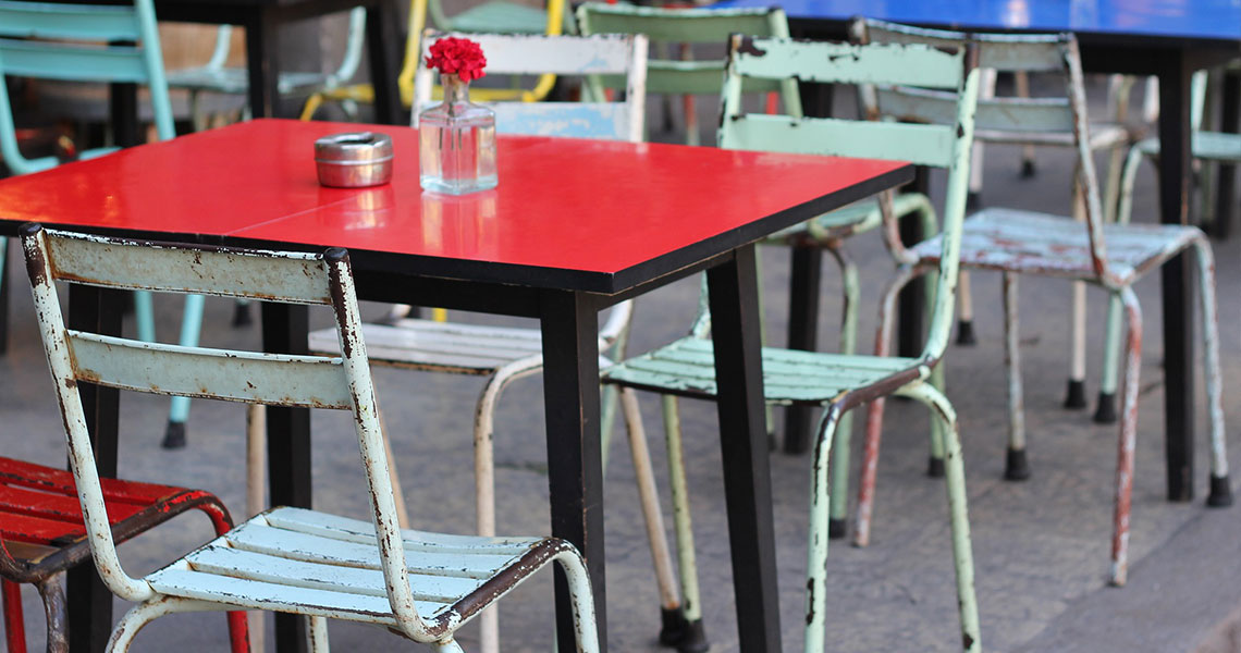 metal cafe chairs with paint peeling and rust