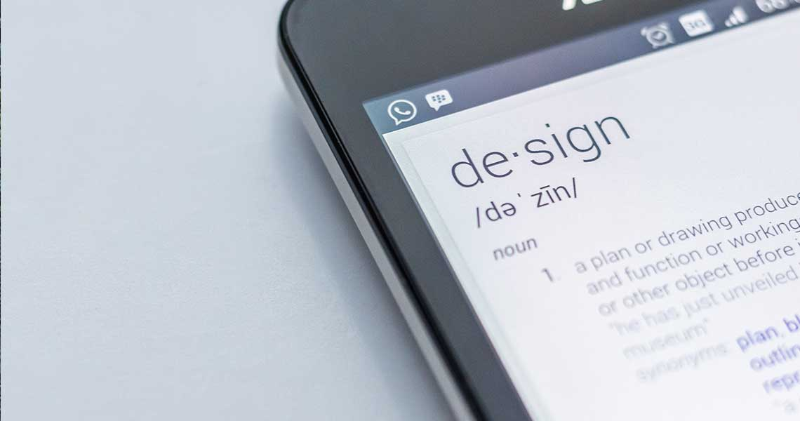 mobile phone displaying definition of the word design