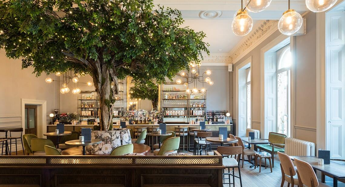 Botanical themed interiors featuring fake trees