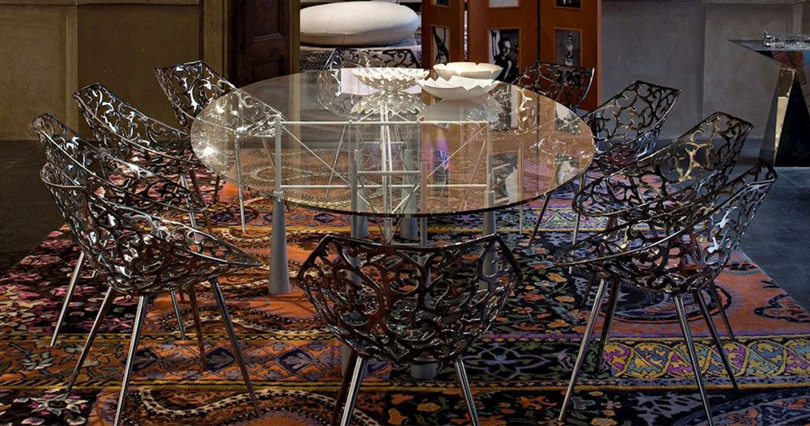 stainless steel chairs around a class table in an upmarket hotel