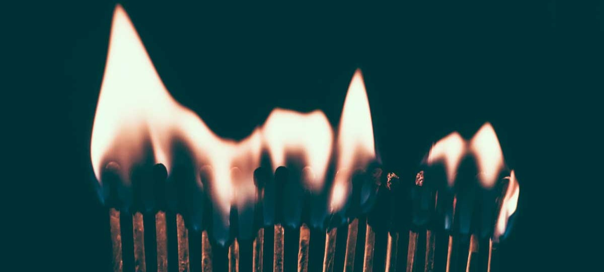 a line of matches burning with flames