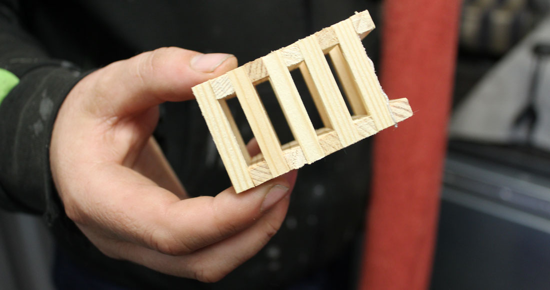 hand holding a wooden crib 5 stack