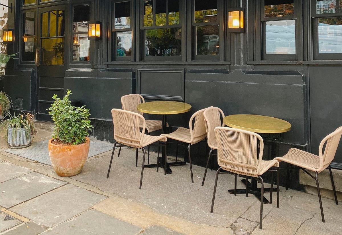 gold-notting-hill-restaurant-satin-brass-table-tops