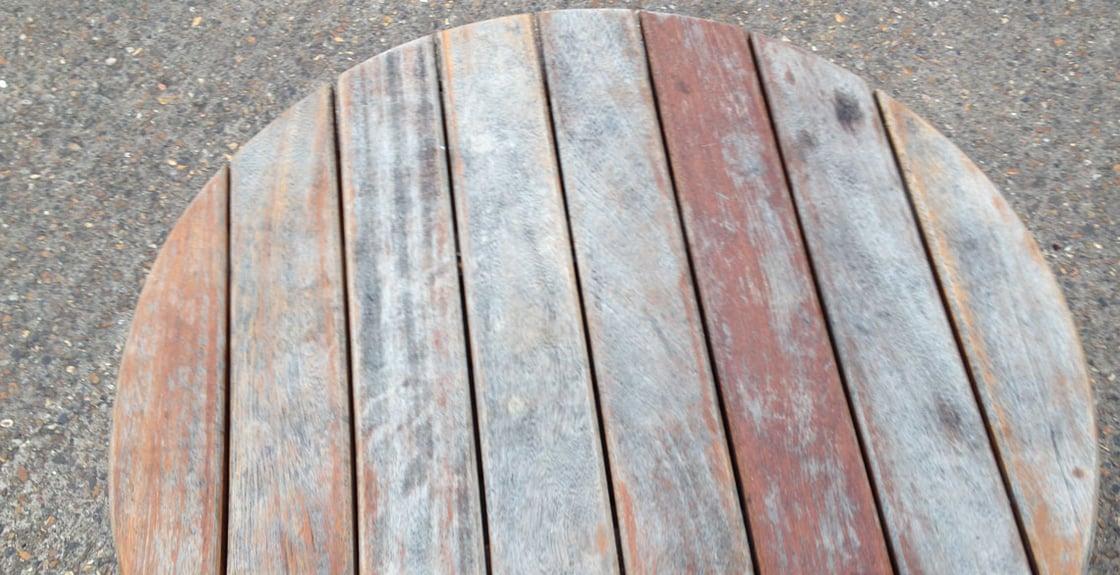 iroko table top weathered by outdoor exposure