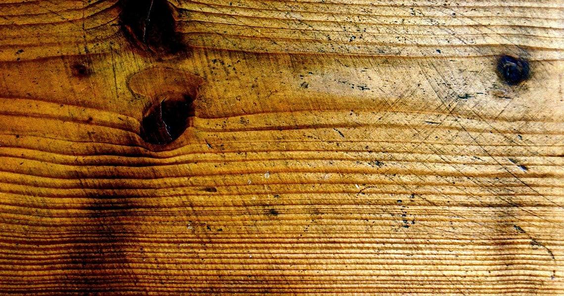 scuffed blackened wood that needs repair