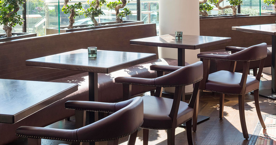 tables with an arised edge profile in a hotel restaurant
