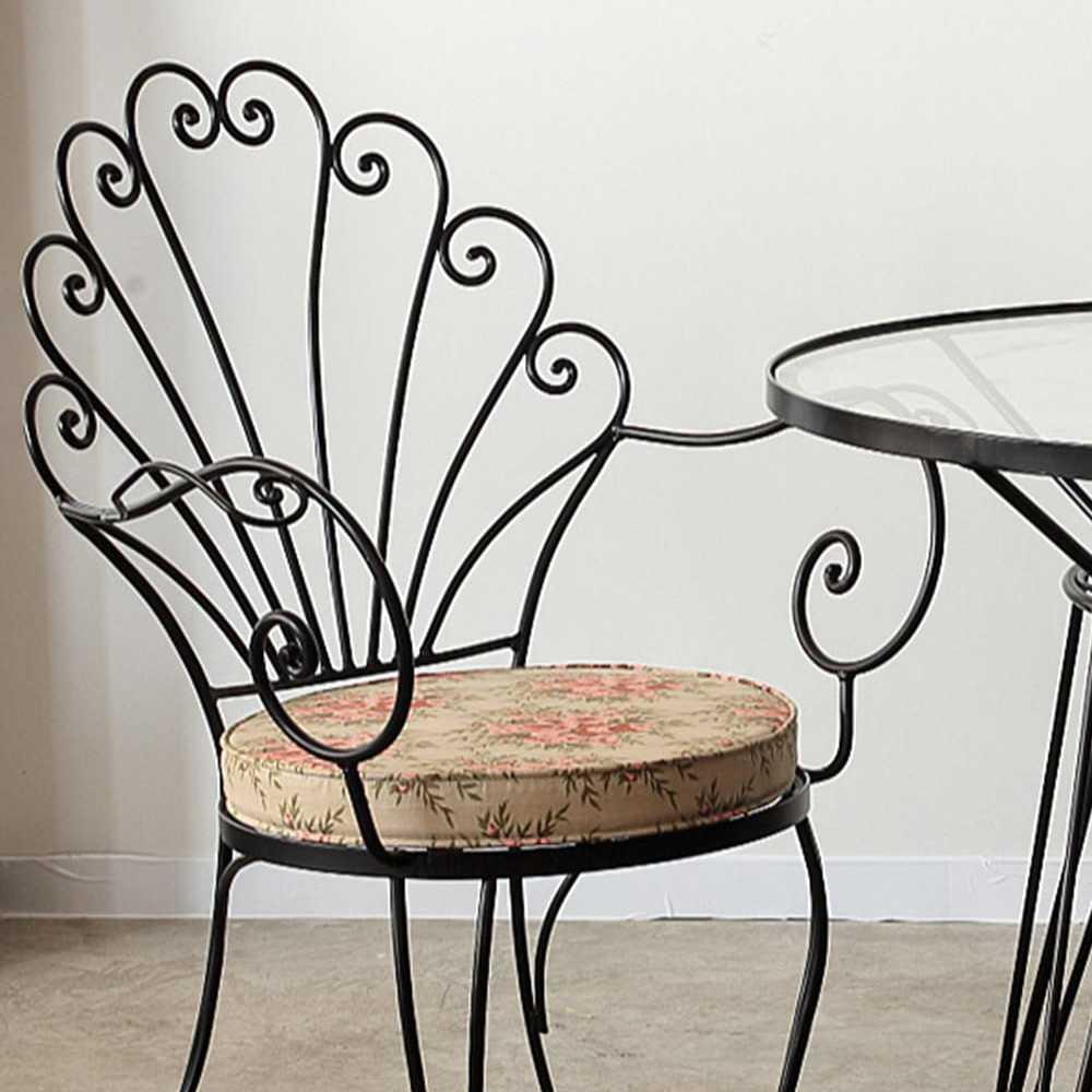 Curl metal armchair
