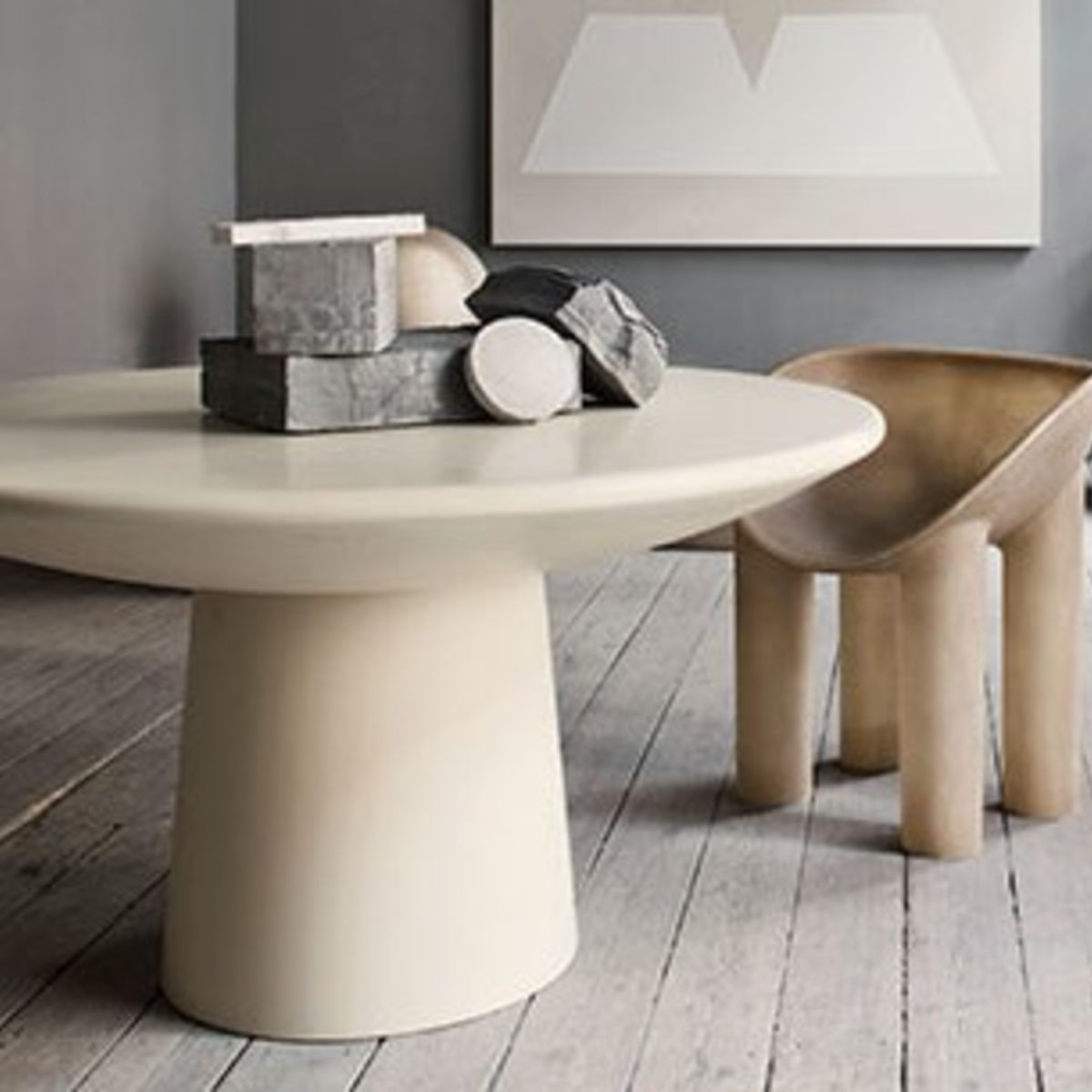 A photo of a table with a roly-poly stool