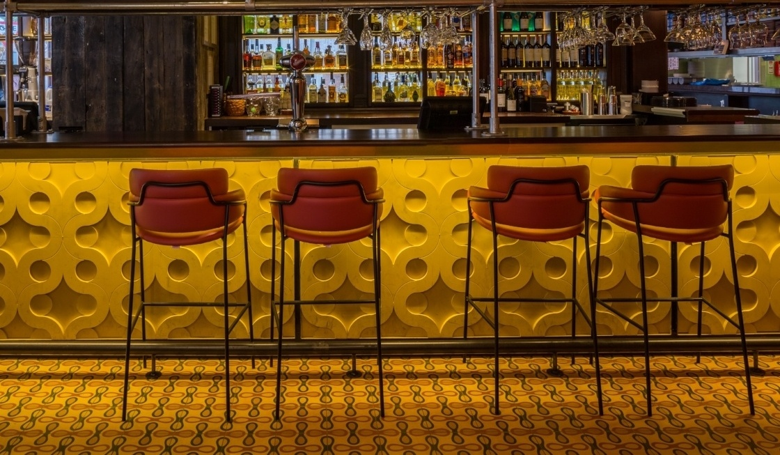 Las Iguanas Chester with retro bar and patterned floor tiles.