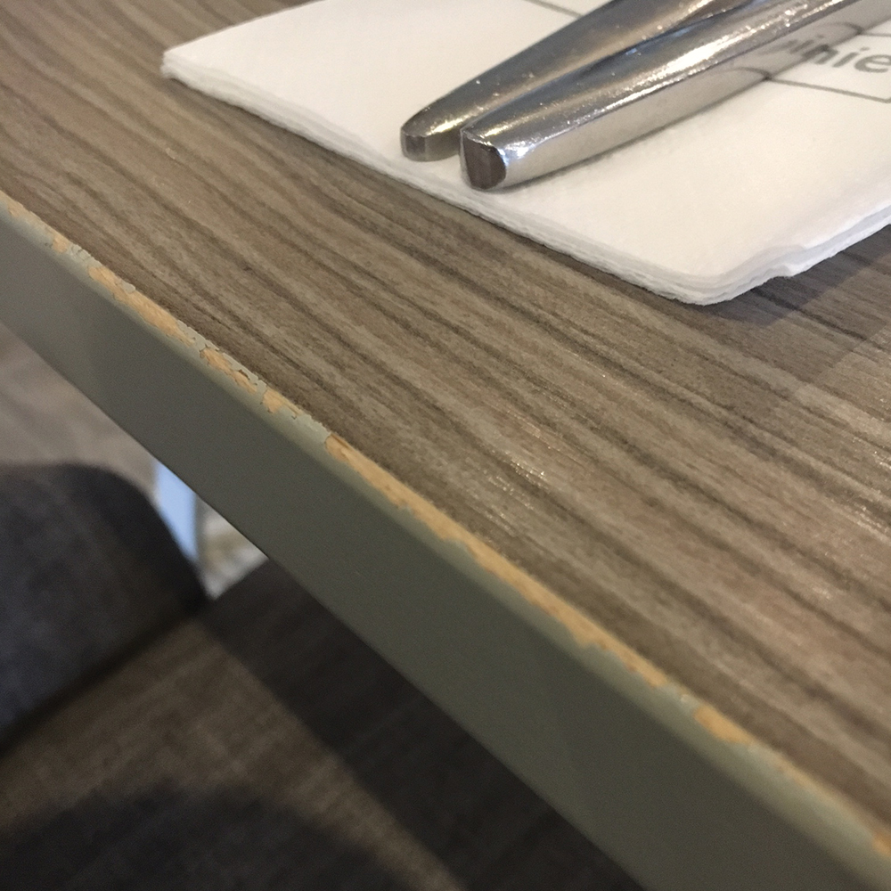 Stain from sanitisers on wooden table top