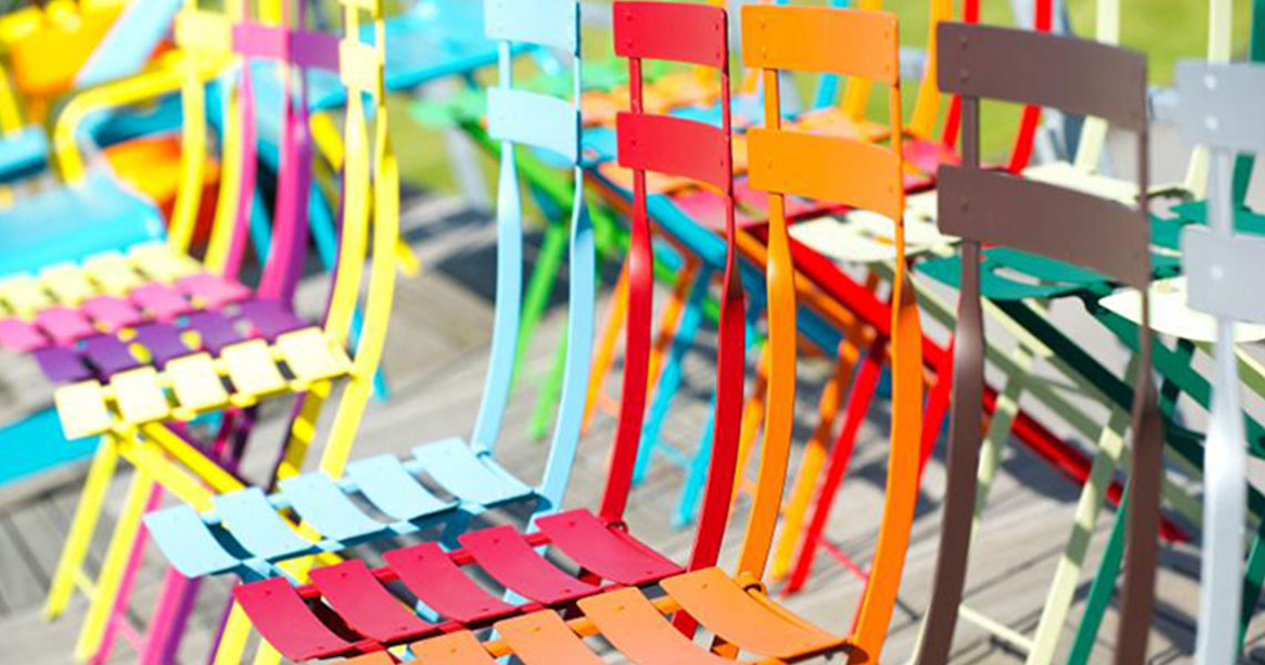 colourful metal cafe chairs in a row