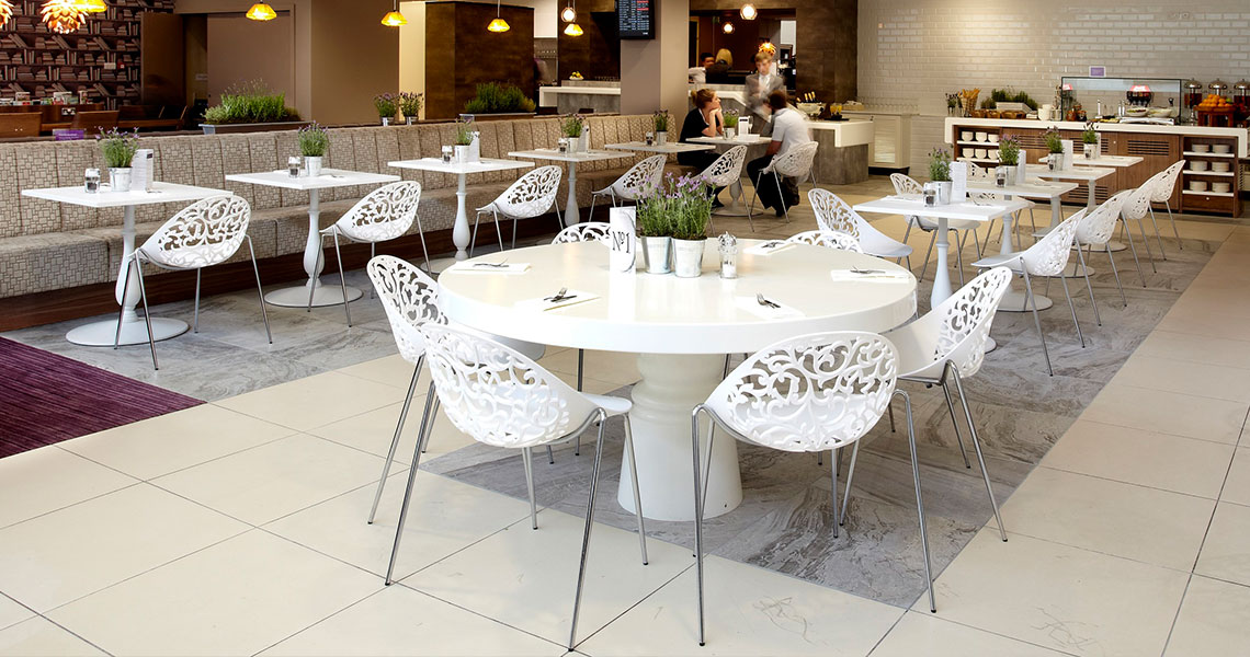 plastic dining chairs in an airport lounge cafe