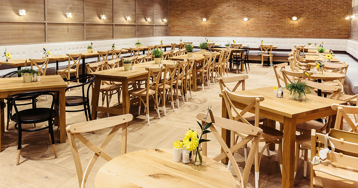 wooden dining chairs and tables in a cafe