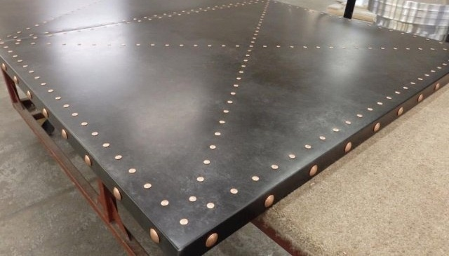 patterned-rivets-on-metal-table-top